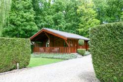 Pleasant and comfortable holiday cottage in a wooded estate in Hotton